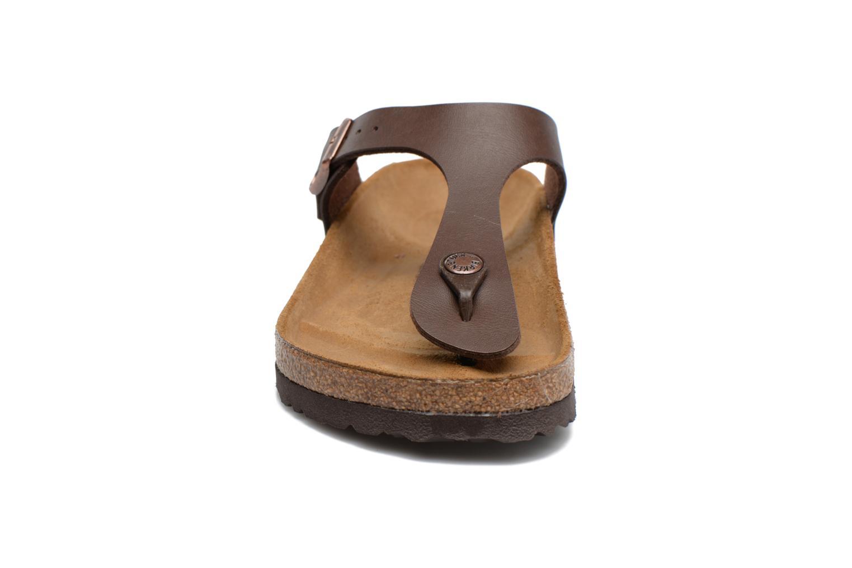Flip flops Birkenstock Gizeh Flor W Brun bild av skorna på