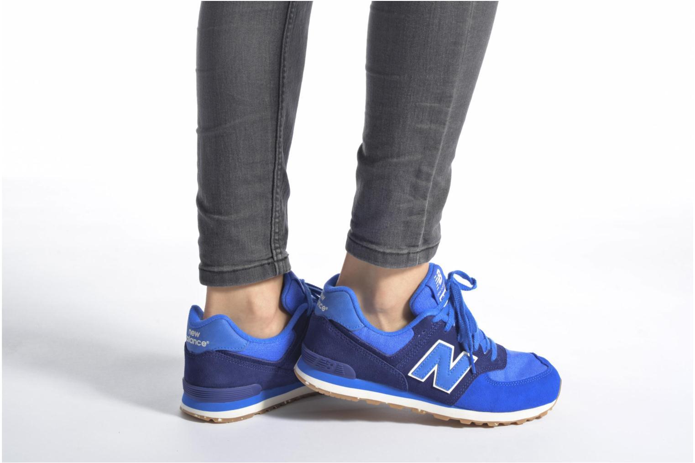 Sneaker New Balance KL574 J rot ansicht von unten / tasche getragen