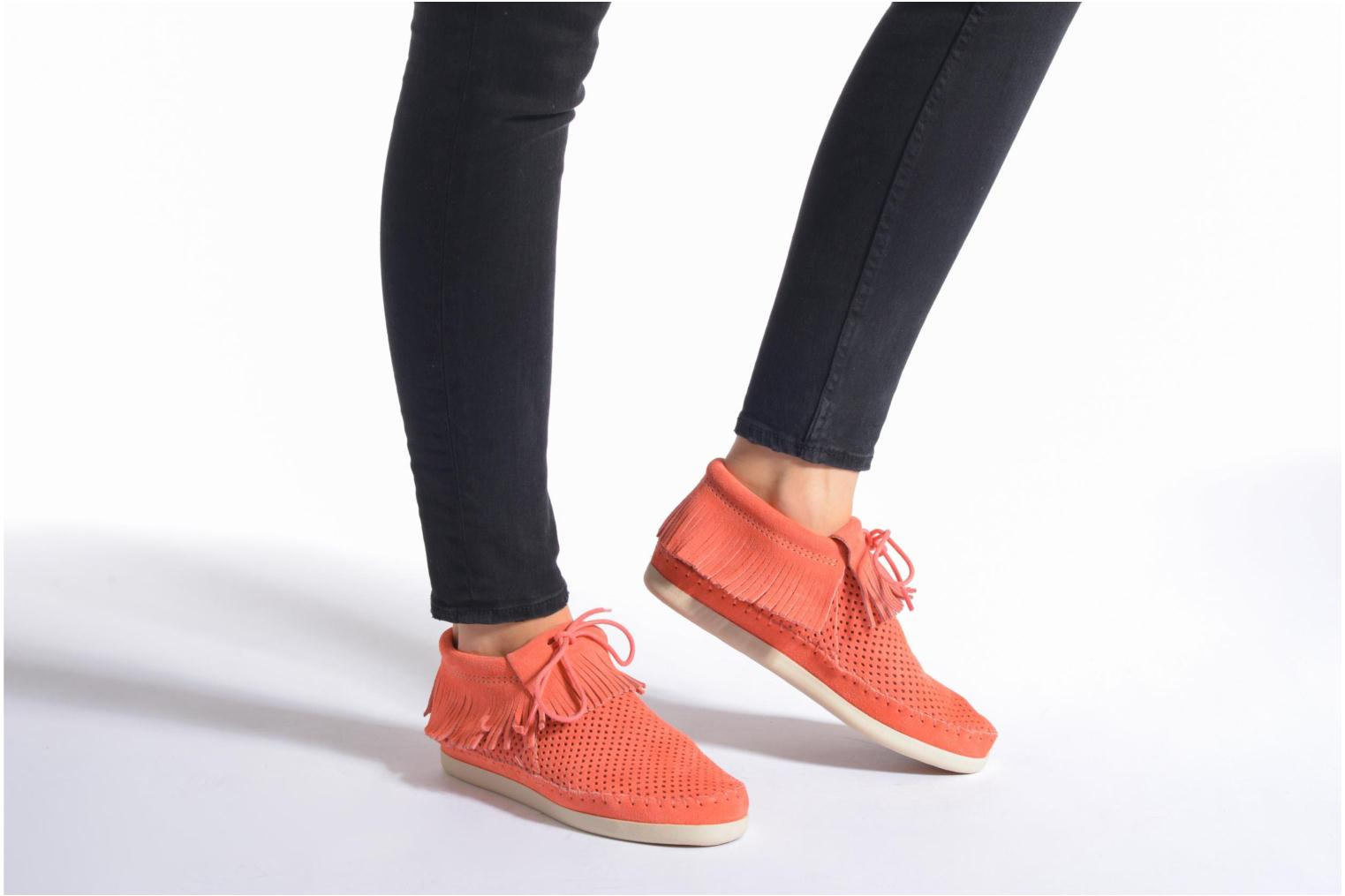 Ankle boots Minnetonka Venice Perf Orange view from underneath / model view