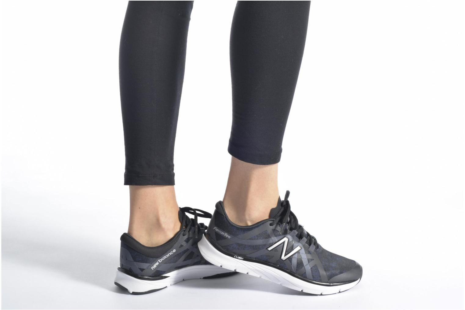 Sport shoes New Balance WX811 Black view from underneath / model view