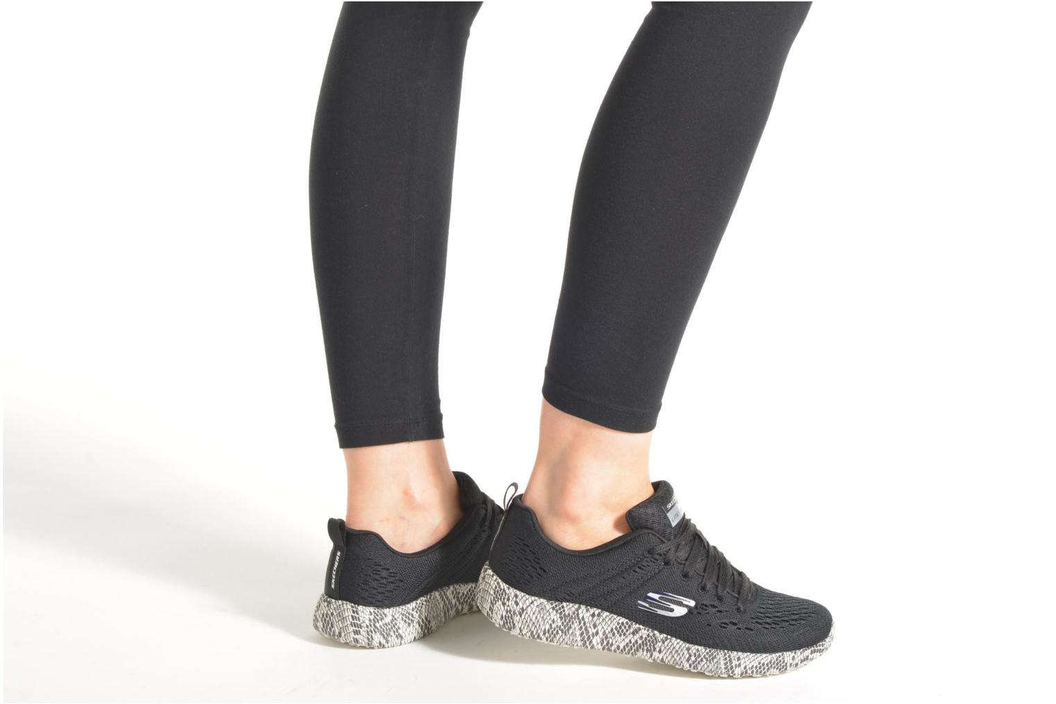 Sport shoes Skechers Burst Black view from underneath / model view